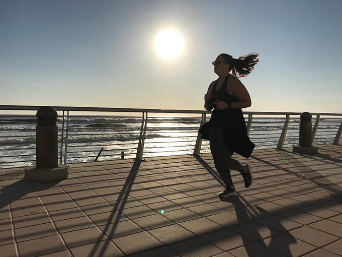 Morning Sunlight Over the Atlantic Warms Daytona Beach Jogger